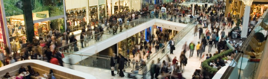 People in shopping mall looking for products to test.